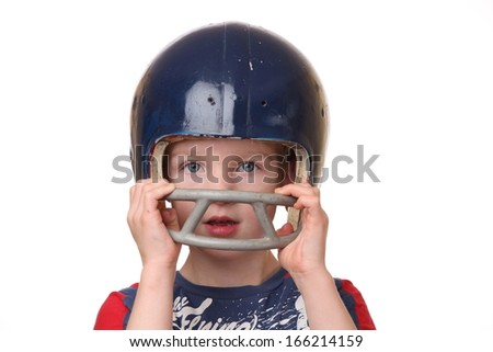 Portrait of a young boy with a football helmet on white background - stock photo
