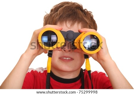 Portrait of a young boy with binoculars - stock photo