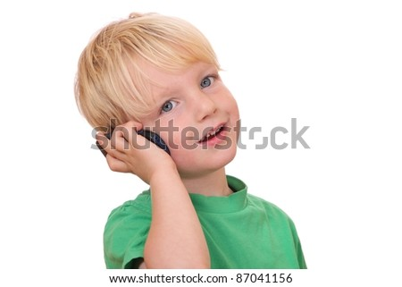 Portrait of a young boy with his new cell phone - stock photo
