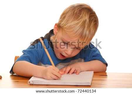 Portrait of a young boy writing isolated on white background - stock photo