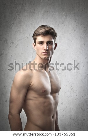 Portrait of a young brawny bare-chested young man - stock photo
