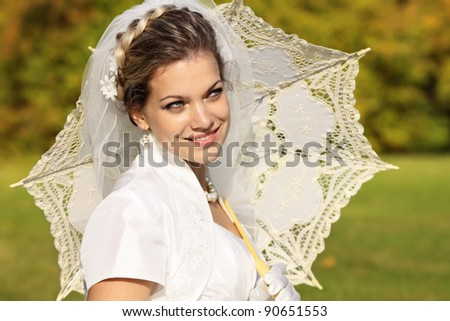 Portrait of a young bride with an umbrella - stock photo
