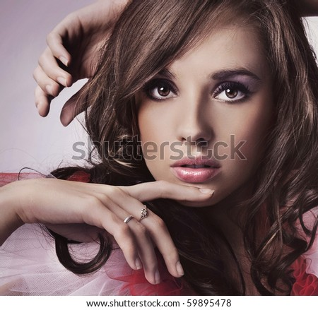 Portrait of a young brunette - stock photo