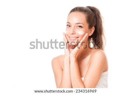 Portrait of a young brunette cosmetics beauty on white background. - stock photo