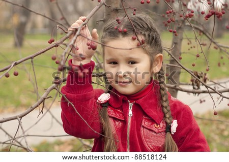 portrait of a young brunette girl in autumn park