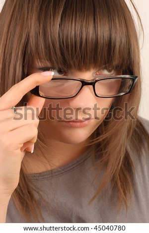 Portrait of a young brunette in glasses - stock photo