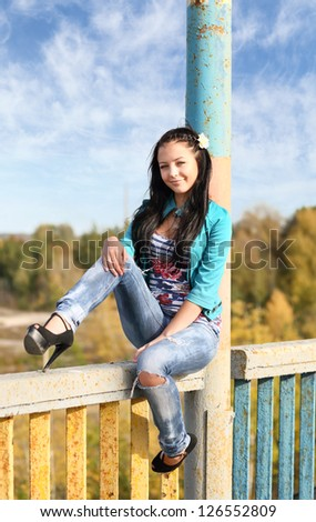 portrait of a young brunette outdoors - stock photo