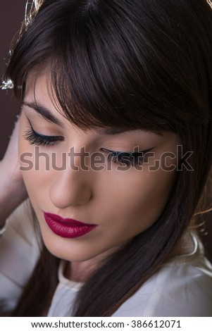 Portrait of a young brunette with closed eyes - stock photo