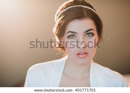 Portrait of a young brunette woman with make-up and hairstyle, lifestyle, beauty