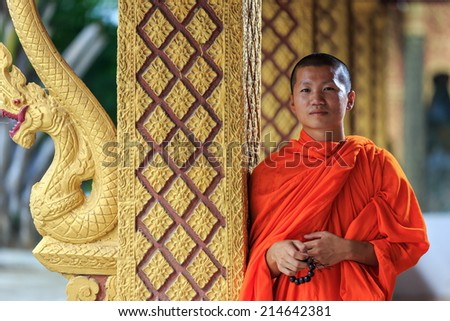 Portrait of a young Buddhist monk, looking in camera - stock photo