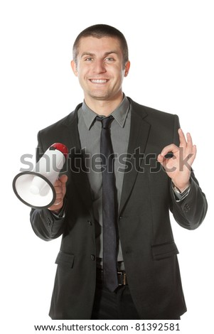 Portrait of a young business man having good news - stock photo
