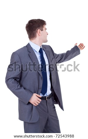 portrait of a young business man holding his arm out presenting something. Room to add an object, or some text