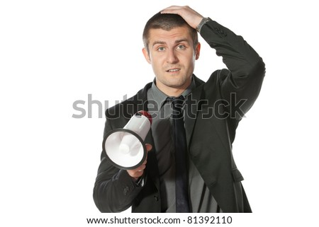 Portrait of a young business man holding megaphone. - stock photo