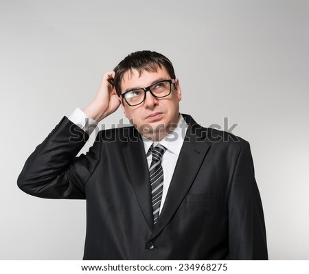 portrait of a young business man making a crazy smile,  - stock photo