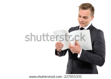 Portrait of a young business man reading journal. Good news concept. Isolated on white background. - stock photo