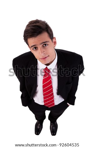 Portrait of a young business man view from above; isolated on white background. studio shot - stock photo