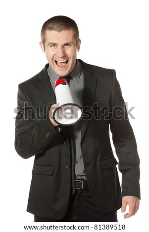 Portrait of a young business man yelling into a megaphone. - stock photo