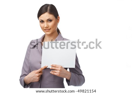 Portrait of a young business woman pointing on the paper she is holding - stock photo