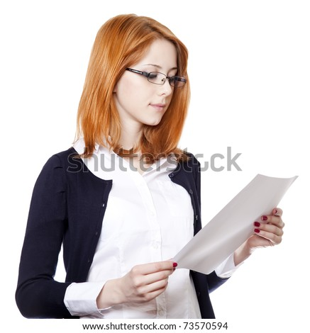 Portrait of a young business woman reading paper. Studio shot. - stock photo