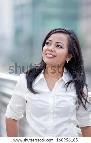 Portrait of a young business woman smiling
