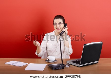 Portrait of a young business woman speaking on the phone