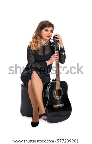 Portrait of a young business woman with guitar isolated on white background
