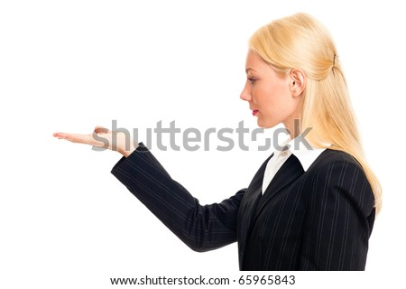 Portrait of a young business woman. with her hand outstretched, as though she is presenting something - stock photo