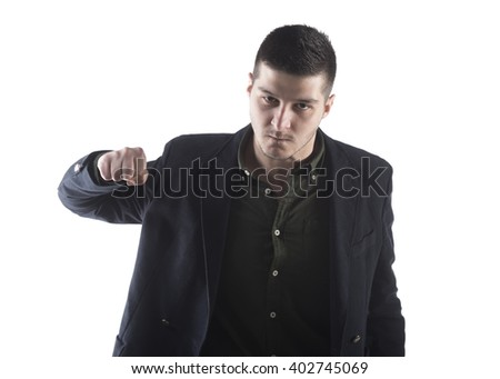 portrait of a young businessman angry with a fist on a white background - stock photo