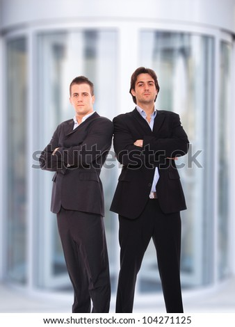 Portrait of a  young businessman at corporate entrance - stock photo