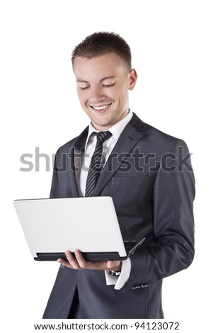 Portrait of a young businessman holding a laptop against a white background - stock photo