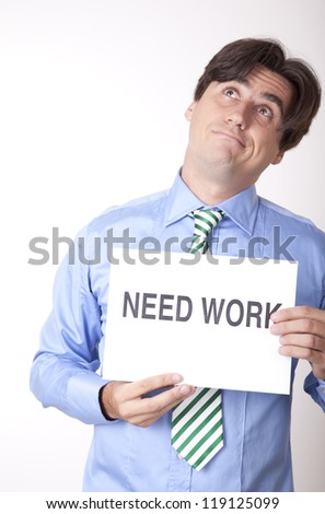 Portrait of a young businessman holding a sign need work. - stock photo