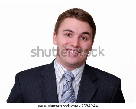 Portrait of a young businessman in a dark suit, smiling. Isolated against white.