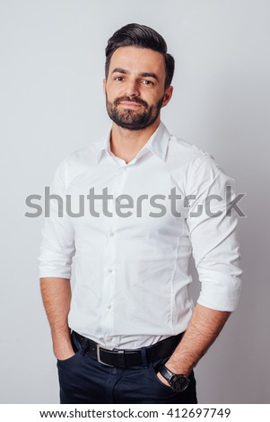 Portrait of a young businessman in a white shirt - stock photo
