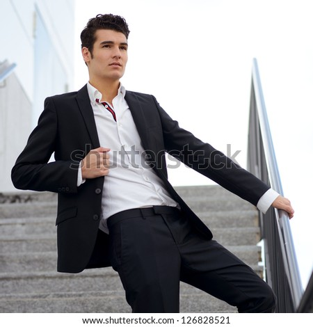 Portrait of a young businessman in an office building - stock photo
