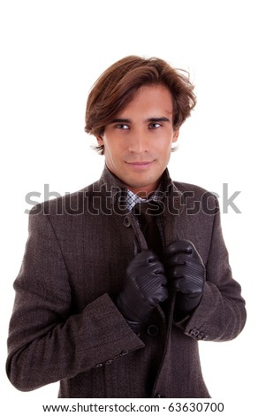 Portrait of a young businessman, in autumn/winter clothes, isolated on white. Studio shot - stock photo