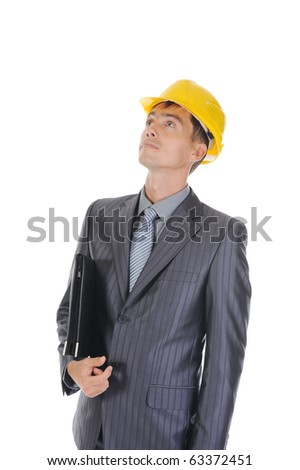 Portrait of a young businessman in the construction helmet, looking up. Isolated on white background