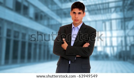 Portrait of a young businessman, over light business background
