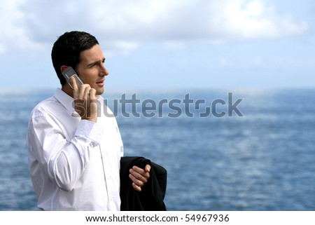 Portrait of a young businessman phoning