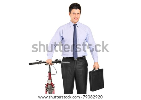 Portrait of a young businessman posing next to a bicycle isolated on white background - stock photo