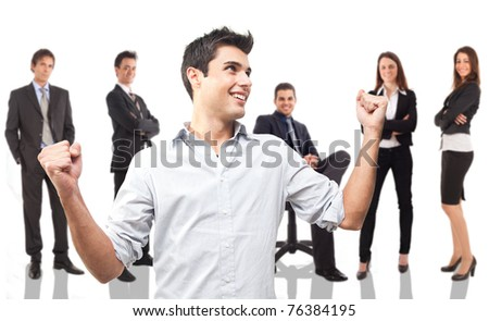 Portrait of a young businessman raising his hands in sign of victory. - stock photo