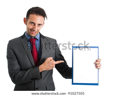 Portrait of a young businessman showing a blank sheet - stock photo