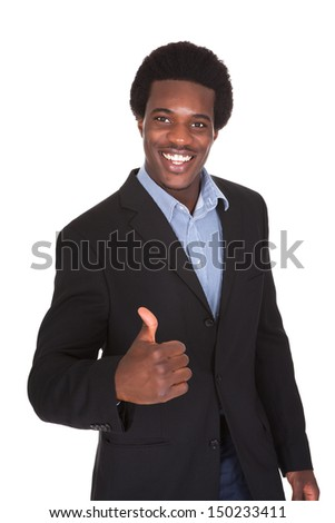 Portrait Of A Young Businessman Showing Thumbs Up Sign