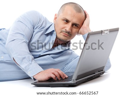 Portrait of a young businessman sitting relaxed at his laptop