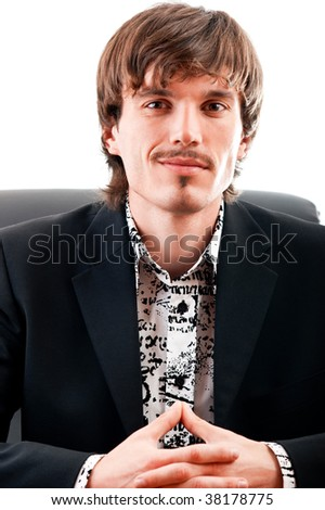 Portrait of a young businessman smiling against white background - stock photo