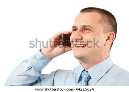 Portrait of a young businessman speaking on mobile phone, isolated on white background