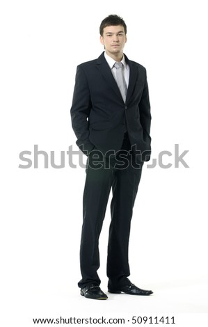 Portrait of a young businessman standing comfortably - stock photo