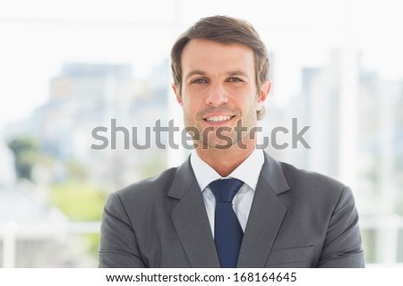 Portrait of a young businessman standing over blurred background outdoors - stock photo