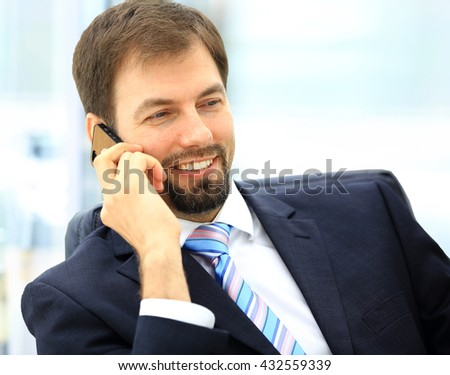Portrait of a young businessman talking on the phone - stock photo