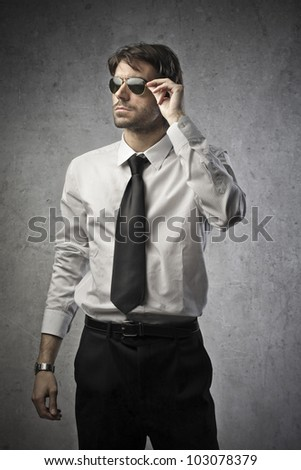 Portrait of a young businessman wearing sunglasses - stock photo