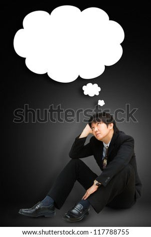 Portrait of a young businessman with a empty speech bubble over his head - stock photo